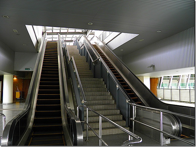 Escalators to monorail platform.