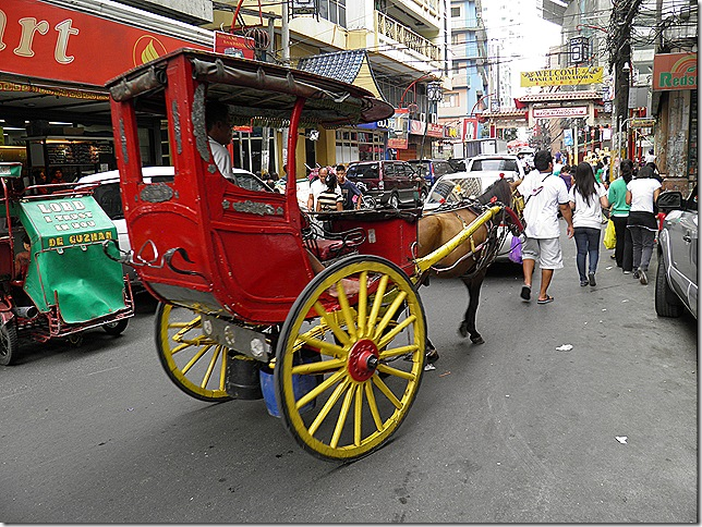 Binondo, Manila's Chinatown. Calesa's are still used for general transport purposes but of course the drivers prefer the rich pickings of a foreign tourist.
