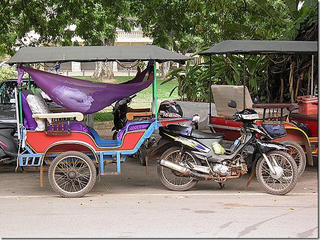 Tuk tuk driver having a kip kip.