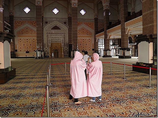 Pink robed sightseers.