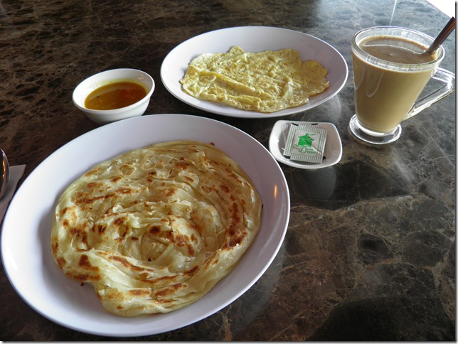 Omelette, paratha, dhal and coffee.