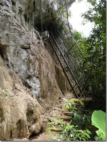 Metal ladders at Gunung Senyum Caves make access easy.