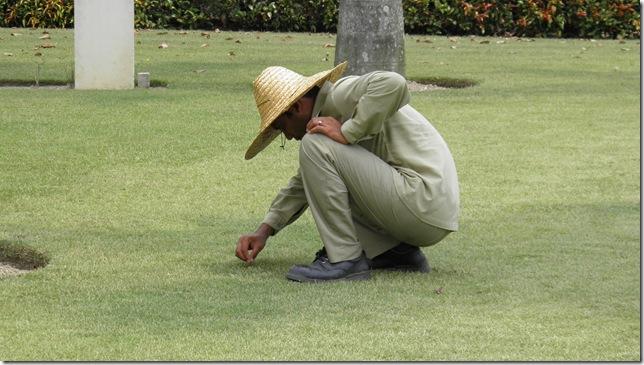 Mr Faisal tending the grass at KL Cheras Road Civil Cemetery