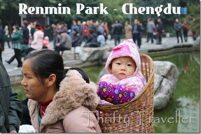 Child in a basket at Renmin Park, Chengdu