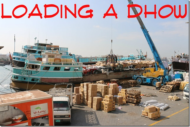 Note the tractor and cars being shipped on deck underneath a pile of boxes. Let's hope they do not encounter rough seas!