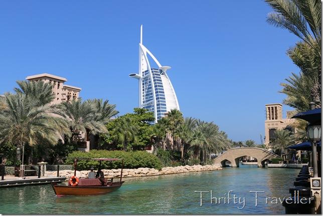 Electric powered abra at Madinat Jumeirah with Burj Al Arab behind.