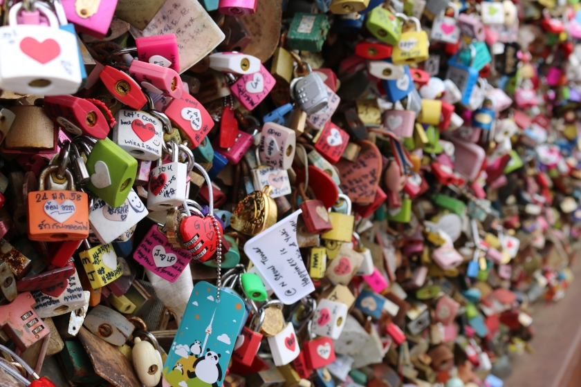 Love padlocks attached to railings at Seoul Tower