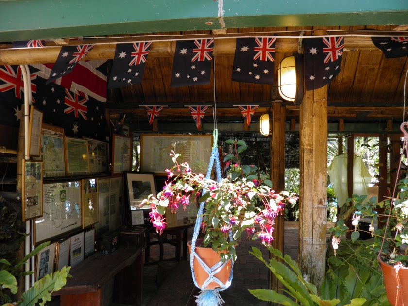 The wall of his shop displays his awards and information concerning the Sandakan-Ranau Death March. Mr Sevee sells plants, cultivated by himself, to help cover the costs of maintaining the memorial.