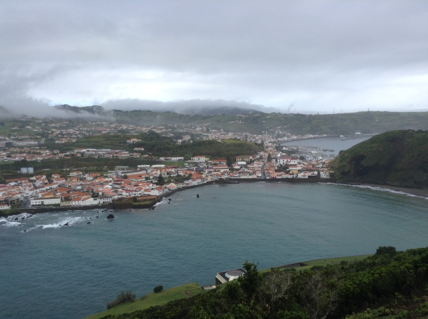 View of Horta from Monte Guia. After a bracing walk you can return to Horta town via Porto Pim beach and perhaps enjoy a very fine sangria on the terrace of the Taberna Pim restaurant while watching the waves break against the harbour wall.