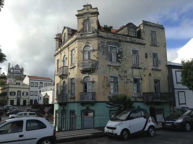 An elegant building in Horta in need of a new coat of paint.