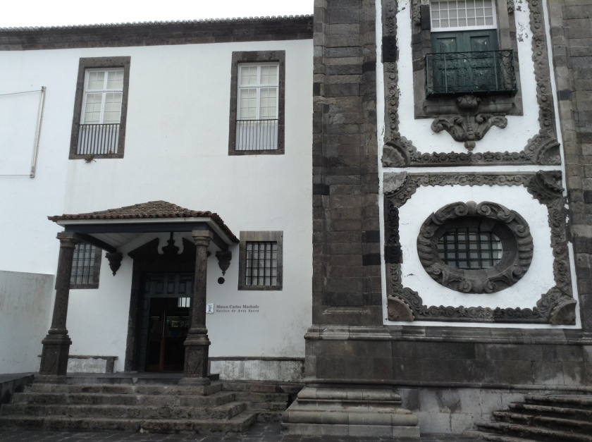 The Museum of Sacred Art at Igreja do Colégio, Ponta Delgada. This museum at the former Jesuit College and Church contains a magnificent 18th century carved wood altar piece described as the greatest wooden monument in Portugal.