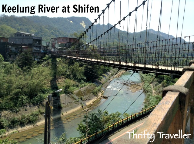 A pedestrian suspension bridge crosses the Keelung River at Shifen.