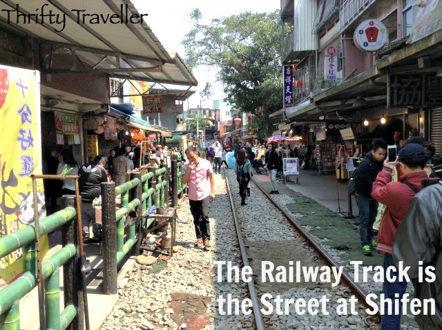 The railway line forms the main street at Shifen.