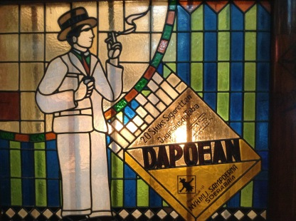 Nice art-deco stained-glass windows advertising Sampoerna products.